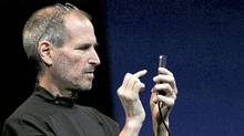 Apple CEO Steve Jobs demonstrates the new iPhone 4 as he delivers the opening keynote address at the 2010 Apple World Wide Developers conference June 7, 2010 in San Francisco. (Justin Sullivan/Getty Images)