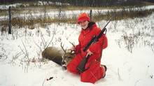 Jenna Gall in 2007 with the first deer that she killed on her own.