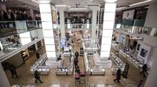 People shop inside at the Hudson's Bay Company (HBC) flagship department store in Toronto on January 27, 2014. (MARK BLINCH/REUTERS)