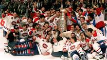 The Montreal Canadiens pose for a photograph with the Stanley Cup following their 4-1 victory over the Los Angeles Kings in Montreal in this June 9, 1993 file photo (Frank Gunn/The Canadian Press)