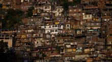 Impoverished migrants who moved to Rio to serve its wealthy elites staked out shelter on the steep hills around the city, leading to the hallmark architecture of the first favelas. Their geography makes them an easy place for gangsters to carve out a redoubt, and difficult for police to control or the city to provide basic services such as sewage. (DADO GALDIERI/Bloomberg)