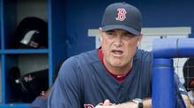 Boston Red Sox manager John Farrell watches from the dugout as the Red Sox get ready to take on the Toronto Blue Jays in MLB Grapefruit League baseball action Dunedin, Fla., on Monday, Feb. 25, 2013. (The Canadian Press)