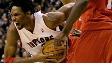 Toronto Raptors' Chris Bosh drives past Philadelphia 76ers Samuel Dalembert during first half NBA action in Toronto on Wednesday, February 10, 2010. (CHRIS YOUNG)