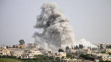 Smoke billows following a reported air strike on a rebel-held area in the southern Syrian city of Daraa, on April 8, 2017. (MOHAMAD ABAZEED/AFP/Getty Images)