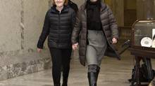 Alberta Premier Alison Redford arrives at the Alberta Legislature with her daughter Sarah in Edmonton, Alberta on March 20, 2014, the day after her resignation. (JASON FRANSON/THE CANADIAN PRESS)