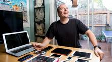 Leander Kahney, who publishes the Cult of Mac website, displays some of his family's Apple devices. (NOAH BERGER FOR THE GLOBE AND MAIL)