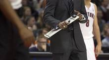 Toronto Raptors head coach Dwayne Casey yells at a referee during a time out in first half NBA action against the Detroit Pistons in Toronto on Wednesday December 19, 2012. (Frank Gunn/THE CANADIAN PRESS)