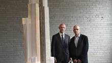 David Mirvish, left and developer Peter Kofman pose for a portrait beside a model of the latest iteration of the Mirvish + Gehry Toronto project on May 27, 2014. (Fred Lum/Globe and Mail)