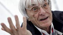 Formula One commercial supremo Bernie Ecclestone gestures as he is interviewed prior to the German F1 Grand Prix at the Nuerburgring circuit July 23, 2011. (ALEX DOMANSKI/Alex Domanski/Reuters)