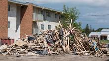 Much of downtown High River, Alberta is vacant and under construction as seen on Tuesday, July 23, 2013. A pile of material sits in a parking lot of a vacant apartment building. (Chris Bolin For The Globe and Mail)