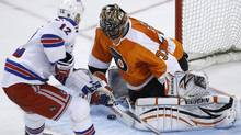 Philadelphia Flyers' Brian Boucher, right, blocks a shot by New York Rangers' Olli Jokinen, of Finland, during a shoot out in their NHL hockey game, Sunday, April 11, 2010, in Philadelphia. Philadelphia won 2-1. (AP Photo/Matt Slocum) (Matt Slocum)