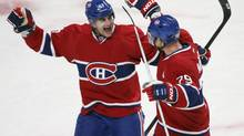 Montreal Canadiens' Andrei Markov (79) celebrates his goal with teammate Max Pacioretty (67) over the Florida Panthers during first period NHL action in Montreal, January 22, 2013. (CHRISTINNE MUSCHI/REUTERS)