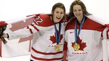 Hayley Wickenheiser , left, and Shannon Szabados celebrate Canada's 2-0 victory over the U.S. in the gold medal game at the Vancouver Olympics. (Peter Power/Peter Power/The Globe and Mail)