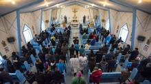 Sunday worshippers at the Church of Our Lady of the Visitation in La Loche, Sask., pray for the victims of Friday's mass shooting. (John Lehmann/The Globe and Mail)