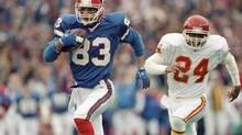 FILE - In this Jan. 15, 1992, file photo, Buffalo Bills wide receiver Andre Reed runs with the ball during an AFC playoff football game against the Kansas City Chiefs in Orchard Park, N.Y. (Mark Duncan/AP)