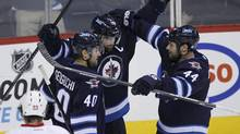 Despite establishing its core, the Winnipeg Jets continue their long-term plan to build from within and to improve incrementally. (JOHN WOODS/THE CANADIAN PRESS)
