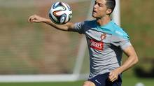 Cristiano Ronaldo controls the ball during a training session of Portugal in Campinas, Brazil, Friday, June 20, 2014. (Paulo Duarte/AP)