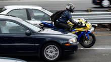 None of the provinces are making it legal for motorcycles to ride in between lanes of traffic – and many experts are stuck in the middle on whether that should change. (Justin Sullivan/Getty Images)