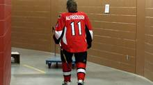 Ottawa Senators Daniel Alfredsson makes his way to a team photo session in Ottawa Saturday, January 12, 2013, as the team gears to start up the shortened hockey season after a prolonged NHL players strike. (The Canadian Press)