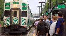 GO passengers wait for an Eastbound train at the Long Branch GO Station in Etobicoke on July 09, 2013, 2013. Shuttle busses were used because of flooding on the tracks West of Long Branch following a massive rain storm Monday night. (Deborah Baic/The Globe and Mail)