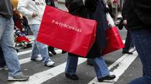 Shoppers carry bags as they walk down Fifth Avenue in New York in this file photo. (CHIP EAST/REUTERS)