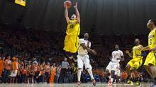 Michigan Wolverines guard Nik Stauskas, 19, is averaging 12.7 points a game and is second in the Big Ten Conference in three-point shooting accuracy (.490). He also leads the Big Ten in free-throw shooting percentage (.833) and three-pointers made (51). (Damen Jackson/Associated Press)