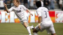 Barry Robson of the Vancouver Whitecaps celebrates his goal against the L.A. Galaxy during the first half of their MLS game in Vancouver, British Columbia July 18, 2012. (BEN NELMS/REUTERS)