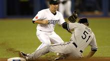 Former Blue Jay Alex Rios, slides in safely to second base, beating the tag by John McDonald during the Toronto Blue Jays home opener versus the Chicago White Sox at Rogers Centre on Monday night, April 12, 2010. (Peter Power/The Globe and Mail)