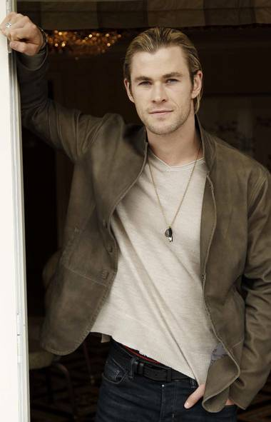 """A request was made by a commenter last week for """"more hotties."""" Here is Chris Hemsworth, who portrays Thor in the film """"The Avengers,"""" standing in your kitchen doorway wondering if you need any help opening that new jar of salsa. (AP)"""
