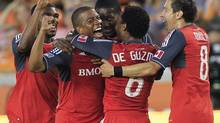 Toronto FC's Ashtone Morgan, Jeremy Hall, Doneil Henry, Julian de Guzman and Eric Avila, from left, celebrate after Hall scored a goal during the fist half of against the Houston Dynamo during an MLS game Wednesday, June 20, 2012, in Houston. (Cody Duty/AP)