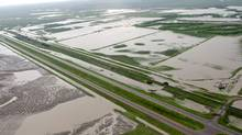 Sections of the Trans Canada highway remain closed and some are underwater east of Medicine Hat, Alta., Monday, June 21, 2010. (CP/Jeff McIntosh/THE CANADIAN PRESS/Jeff McIntosh)