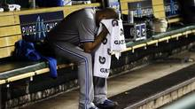 Toronto Blue Jays pitcher Ricky Romero sits on the bench after being relieved against the Detroit Tigers in the sixth inning of a baseball game, Tuesday, Aug. 21, 2012, in Detroit. (Paul Sancya/AP)
