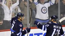 Winnipeg Jets' Evander Kane (L) celebrates his first period goal against the New Jersey Devils with Kyle Wellwood during the first period of their NHL game in Winnipeg, December 3, 2011. (FRED GREENSLADE/REUTERS)