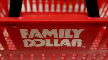 A Family Dollar logo is seen on a shopping basket in Chicago in this file photo. Family Dollar Stores Inc. posted a lower-than-expected quarterly profit on Thursday. (JIM YOUNG/REUTERS)