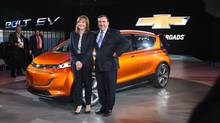 General Motors Chief Executive Officer Mary Barra and Executive Vice President and President of North America Alan Batey introduce the 2016 Chevrolet Volt at the North American International Auto Show in Cobo Center in Downtown Detroit Monday Jan. 12, 2015. (Tanya Moutzalias/AP)