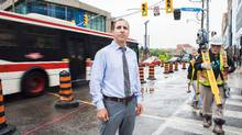 City councillor Josh Matlow, on the corner of Yonge Street and Eglinton Avenue in Toronto, fears that building condo towers without accompanying office space will result in the busy intersection becoming a 'bedroom community in the sky. We need more balance.' (Jennifer Roberts/The Globe and Mail)