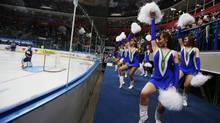 Climate and scores be damned: Cheerleaders thrash relentlessly throughout the World Juniors. (MARK BLINCH/REUTERS)