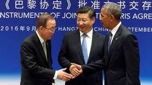 Chinese President Xi Jinping (C), UN Secretary General Ban Ki-moon and U.S. President Barack Obama (R) shake hands during a joint ratification of the Paris climate change agreement ceremony ahead of the G20 Summit at the West Lake State Guest House in Hangzhou, China, September 3, 2016. (REUTERS)