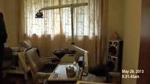 A dentist's chair is seen in the home of Tung Sheng Wu, in an image taken from an investigator's video. (Focus Solutions Group)