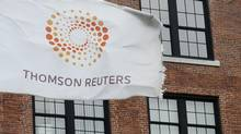A flag displaying the Thomson Reuters logo flies outside a company building in Boston in this file photo. (Lisa Poole/AP)