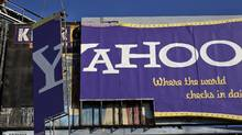 """The """"Yahoo"""" sign, which overlooks the I-80 freeway from 6th St. is dismantled, Wednesday, Dec. 21, 2011 in downtown San Francisco. (Michael Macor/AP/Michael Macor/AP)"""