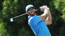 Dustin Johnson hits his tee shot on the 11th hole during the second round of the Tour Championship on Sept. 23, 2016 in Atlanta. (Sam Greenwood/Getty Images)