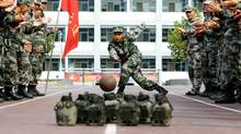 Soldiers in Jinan, Shandong province, enjoy a makeshift bowling break during China's seven-day national holiday. (CHINA DAILY/REUTERS)