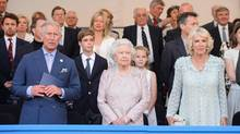 Britain's Prince Charles (front row, L-R), Queen Elizabeth and Camilla, Duchess of Cornwall, stand in the royal box at the Coronation Festival Evening Gala at Buckingham Palace in central London July 11, 2013. (POOL/PA)