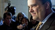 Heritage Minister James Moore speaks to reporters in the foyer of the House of Commons prior to Question Period on May 3, 2010. (Sean Kilpatrick/THE CANADIAN PRESS)