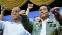 In this Sept. 13, 2016 file photo, Philippine President Rodrigo Duterte, center, poses with Defense Chief Delfin Lorenzana, left. (Bullit Marquez/AP)