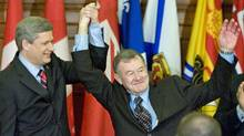 Prime Minister Stephen Harper introduces elected Senator Bert Brown to his caucus in Ottawa on Oct. 17, 2007. (TOM HANSON/The Canadian Press)