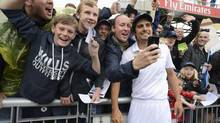 England's captain Alastair Cook poses with fans after the third Ashes cricket test match against Australia finished in a draw and England retained the Ashes at Old Trafford cricket ground in Manchester. (PHILIP BROWN/REUTERS)