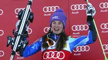 Tina Maze from Slovenia, reacts on the podium after winning the women's World Cup giant slalom race in Aspen, Colo., on Saturday, Nov. 24, 2012. (Alessandro Trovati/AP)