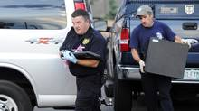 "Investigators carry out a laptop, a hard drive, and other evidence from the apartment of James Holmes, the suspect who opened fire in a movie theater in Aurora, Colorado July 21, 2012. Deliveries received by Holmes, accused of committing a movie house massacre at a Denver-area premiere of the new ""Batman"" film suggest months of ""calculation and deliberation"" leading up to the shooting rampage that killed 12 people, police said on Saturday. (Jeremy Papasso/Reuters)"
